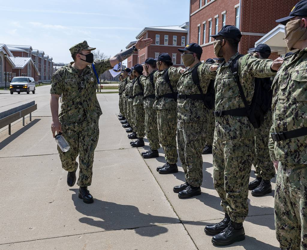 Recruits dress off in formation on the USS Chicago recruit barracks grinder on April 11, 2020, at Recruit Training Command in Great Lakes, Ill.