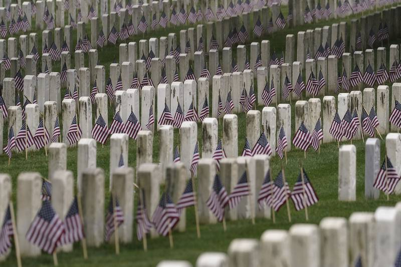 American flags are placed at each headstone in the United States Soldiers' and Airmen's Home National Cemetery ahead of Memorial Day weekend, May 22, 2020, in Washington.