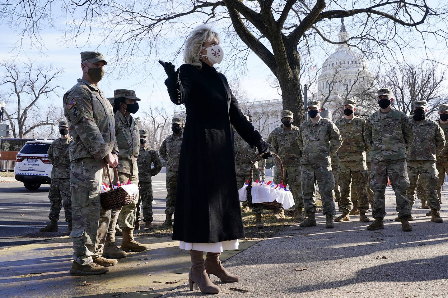 First lady Jill Biden surprises National Guard members outside the Capitol with chocolate chip cookies Jan. 22, 2021, in Washington.