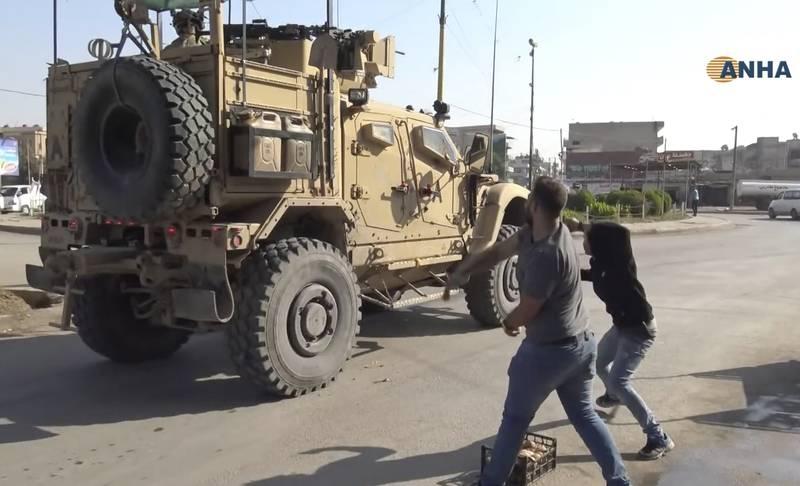Angry Kurds throw potatoes at American military vehicles