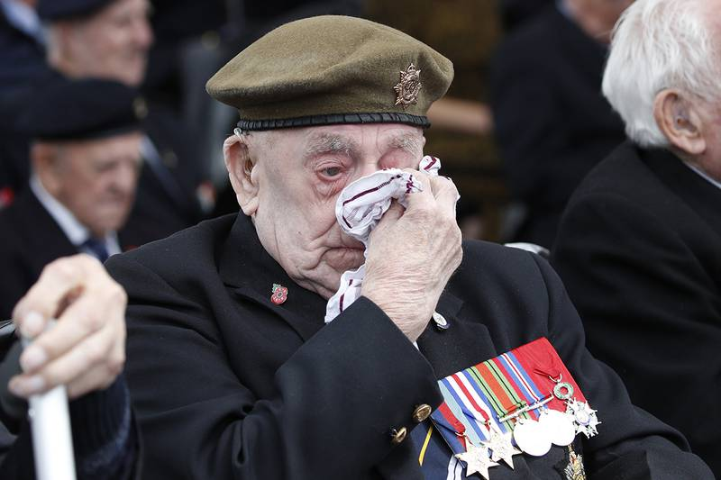 A veteran wipes his eyes during a ceremony to mark the 75th anniversary of D-Day