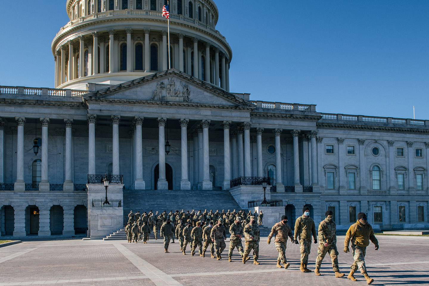 National Guard citizen-soldiers exit after a U.S. Capitol tour on Jan. 23, 2021, in Washington.