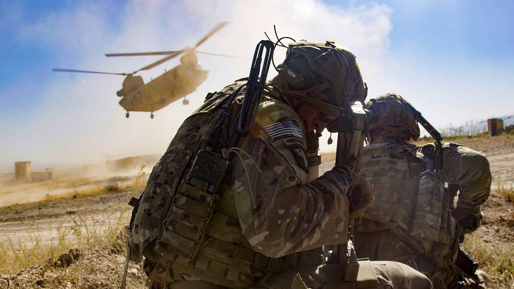The dust kicks up as a CH-47 Chinook helicopter prepares to land in order to extract Afghan National Army and U.S. soldiers following an advise-and-assist mission Sept. 17, 2019, in southeastern Afghanistan.