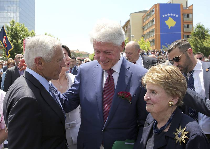 Former U.S. President Bill Clinton, center, speaks with ex-Secretary of State Madeleine Albright, right, and then-NATO commander Wesley Clark during anniversary celebrations in the capital Pristina, Kosovo, Wednesday, June 12, 2019.