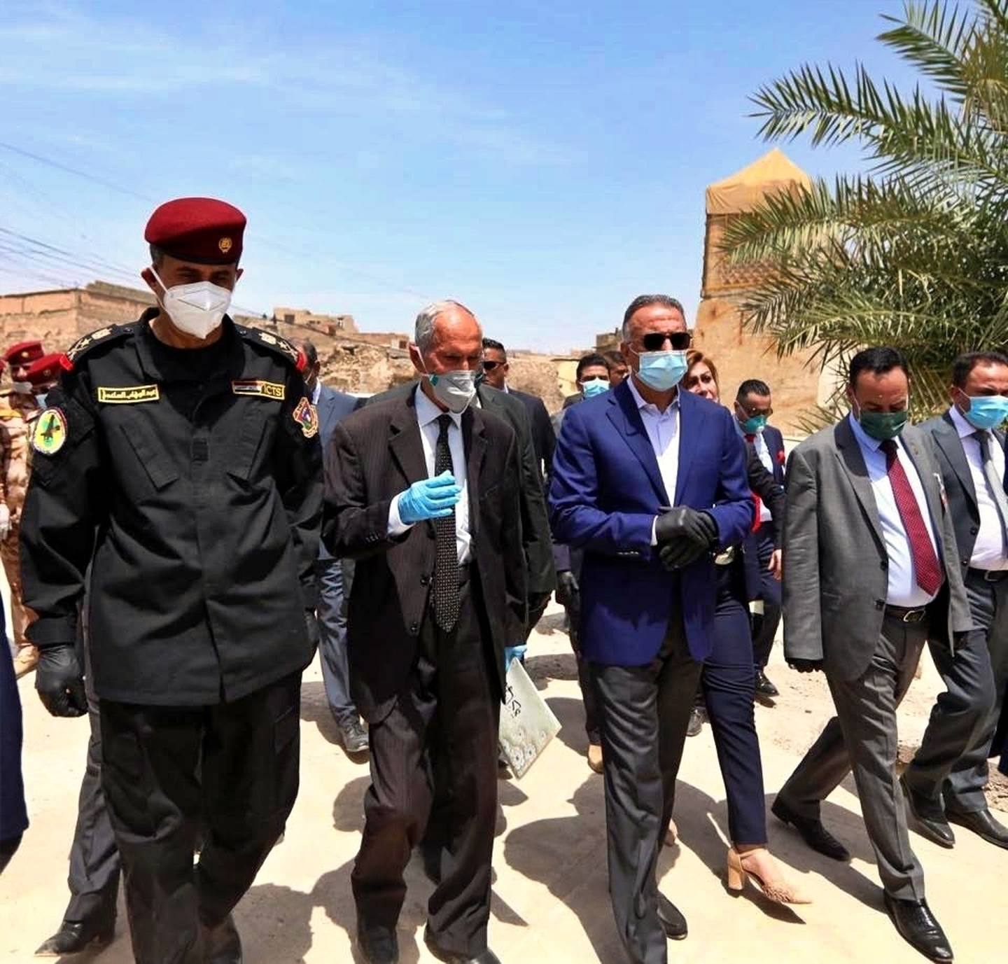 Iraqi Prime Minister Mustafa al-Kahdimi, center, visits the site of the Al–Nuri mosque, which was destroyed by Islamic State militants, during his visit to Mosul, Iraq, Wednesday, June 10, 2020.