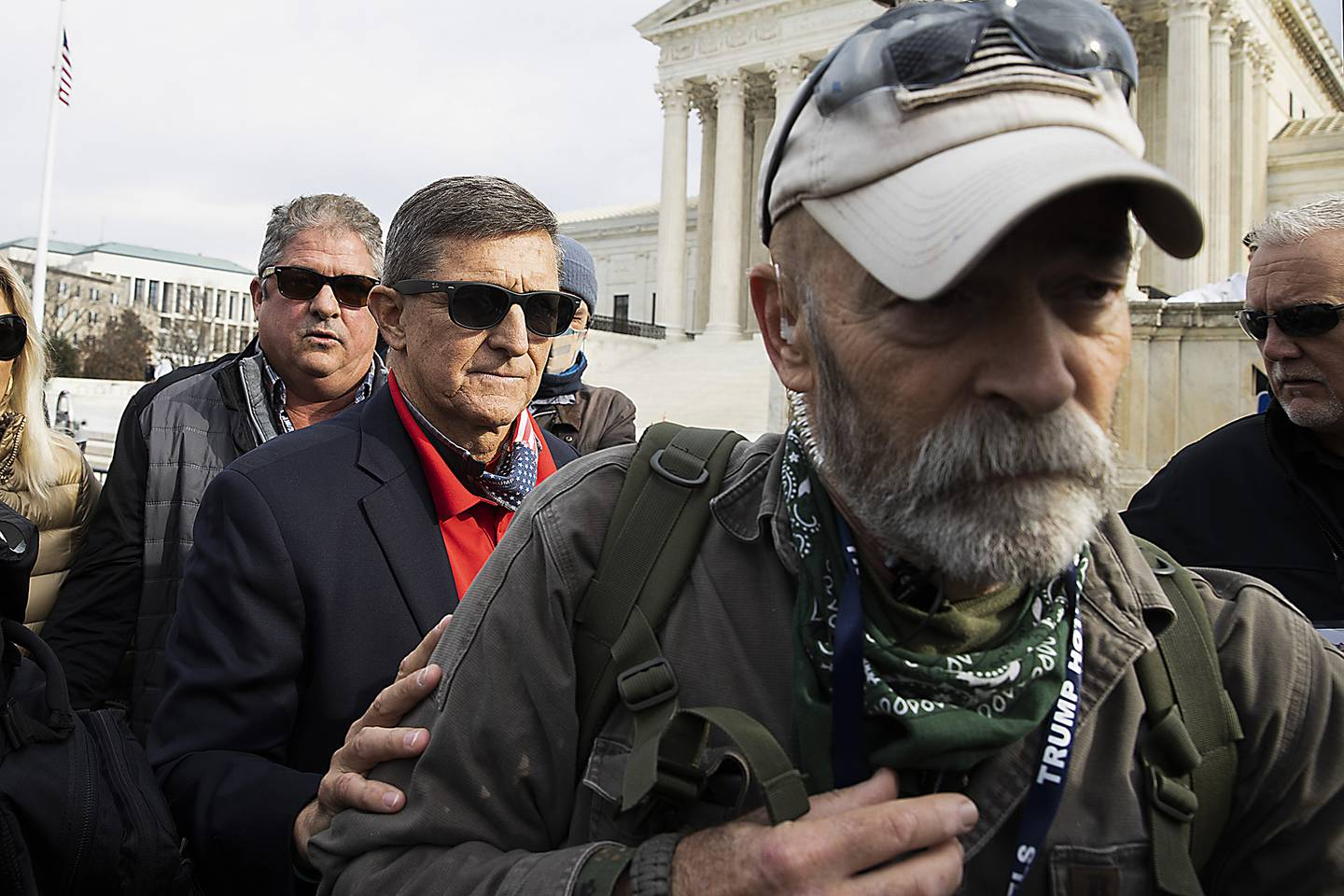 Retired Lt. Gen. Michael Flynn, President Donald Trump's recently pardoned national security adviser, departs a protest of the outcome of the 2020 presidential election outside the Supreme Court on Dec. 12, 2020 in Washington.