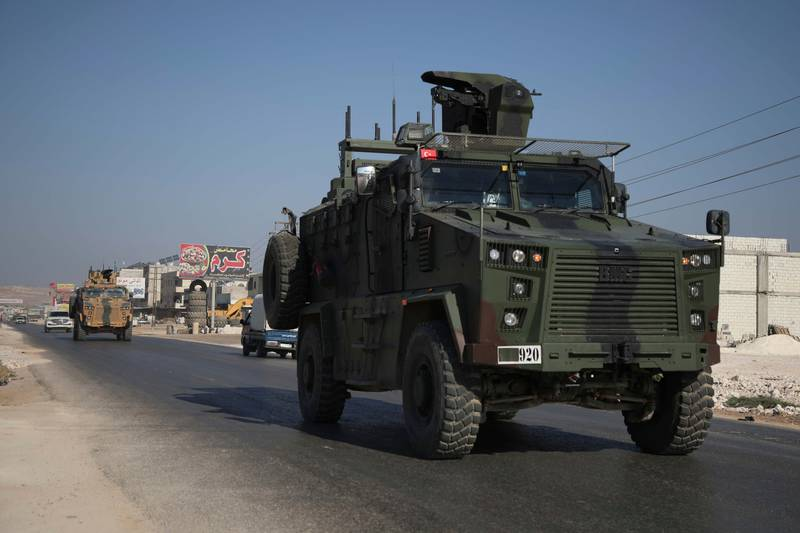 A Turkish army convoy drives along the Bab al-Hawa highway on Aug. 24, 2019, on its way to reinforce a Turkish military observation point in northwestern Syria.