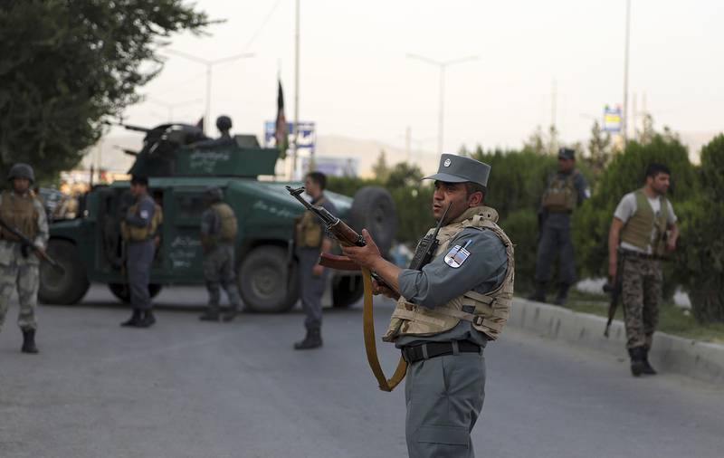 Afghan security personnel secure the site of an attack in Kabul, Afghanistan, on July 28, 2019.