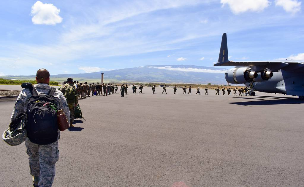 Members of the Hawaii National Guard board an aircraft home after volunteering to assist Maui County with supporting various tasks during COVID-19 operations, Kahului, Hawaii, May 28, 2020.