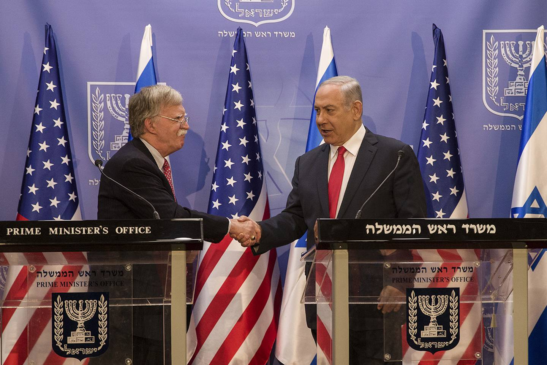 Israeli Prime Minister Benjamin Netanyahu, right, shakes hands with U.S. National Security Adviser John Bolton in Jerusalem