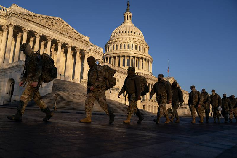 Members of the National Guard gather outside the U.S. Capitol on Jan. 12, 2021, in Washington.