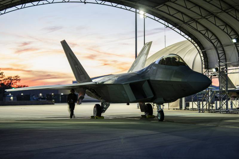 A U.S. Air Force F-22 Raptor assigned to the 325th Fighter Wing undergoes pre-flight checks at Eglin Air Force Base, Florida, Jan. 28, 2021. An F-22 assigned to the wing suffered an in-flight emergency and a ground mishap at Eglin on March 15, 2021. (U.S. Air Force photo by Staff Sgt. Stefan Alvarez)