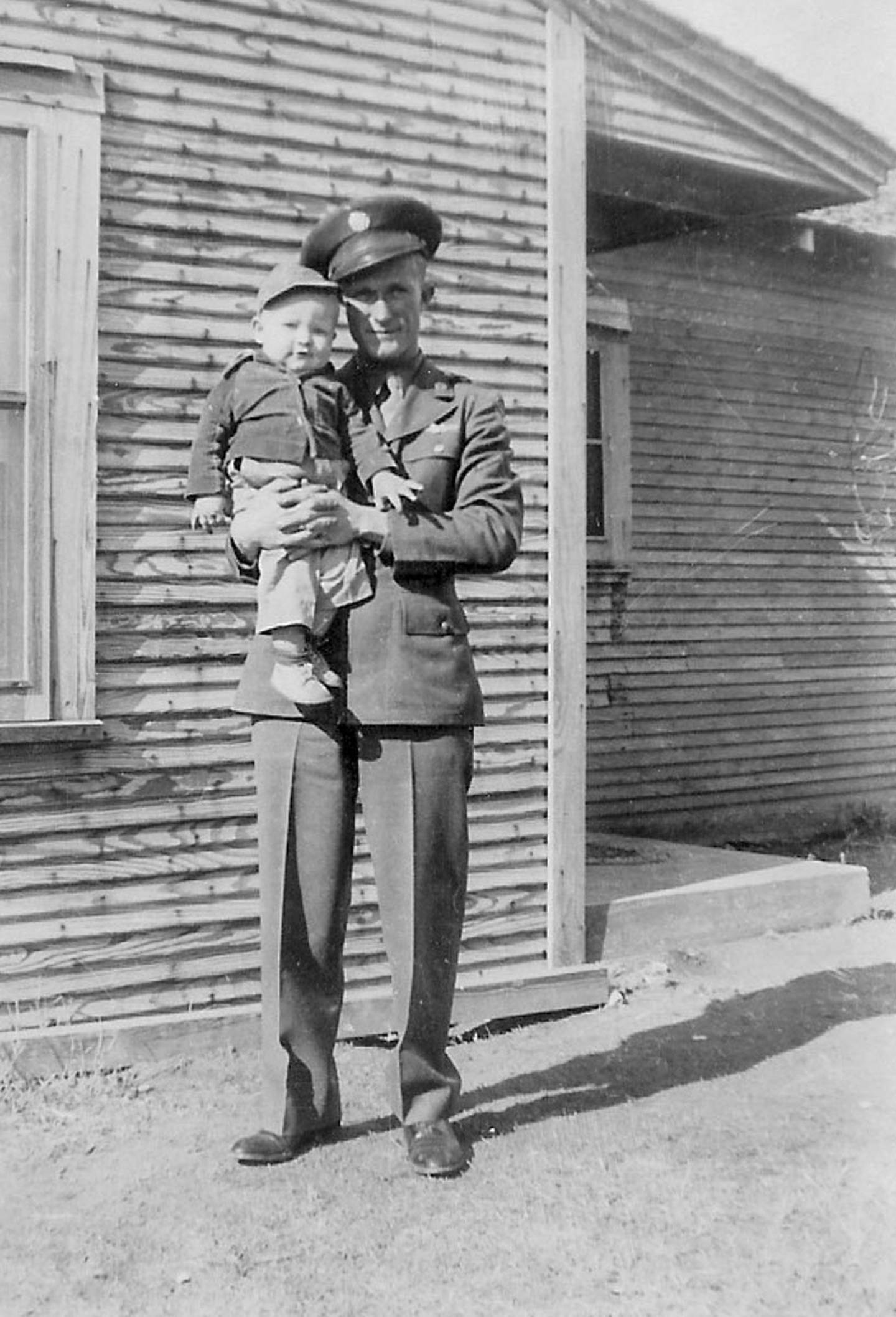 SSgt. Jimmie Doyle, nose-gunner on B-24 Heaven Can Wait, with son, Tommy.