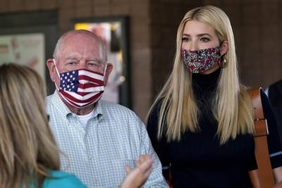 Ivanka Trump, right, and Secretary of Agriculture Sonny Perdue, left, speak with a farming family during a visit to the North Carolina State Farmers Market in Raleigh, N.C., on Sept. 10, 2020.