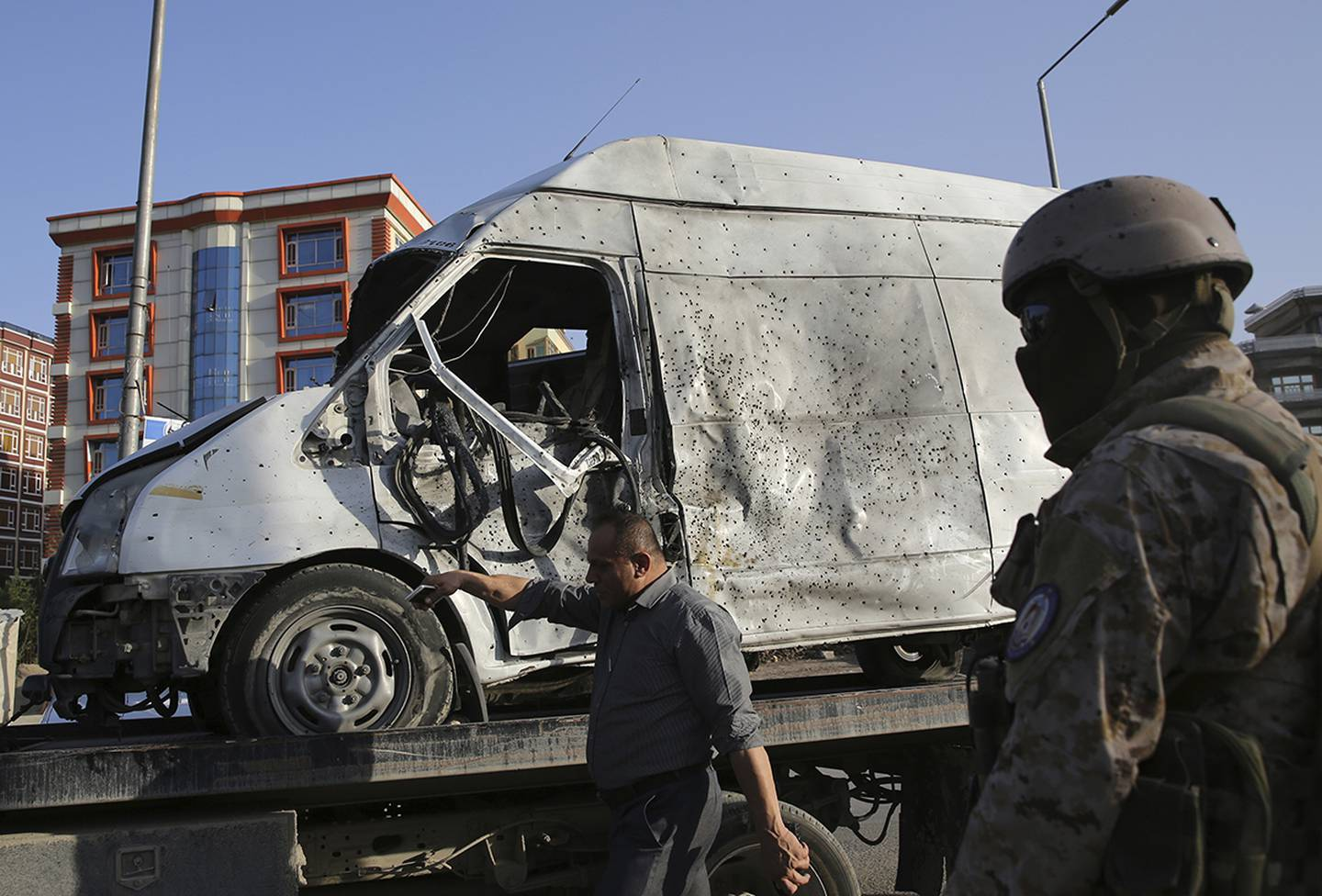 A damaged vehicle is removed from the site of a deadly explosion in Kabul, Afghanistan, Tuesday, Aug. 6, 2019.