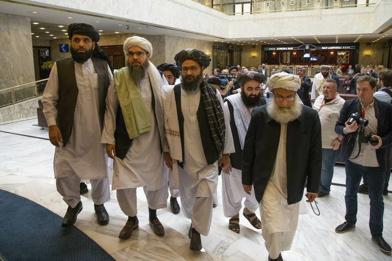 Mullah Abdul Ghani Baradar, the Taliban group's top political leader, third from left, arrives with other members of the Taliban delegation for talks in Moscow.