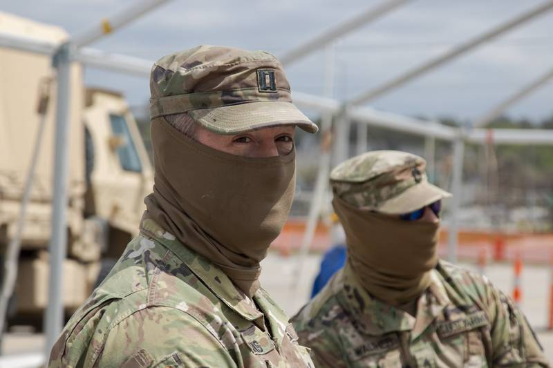Capt. Eric Siemens visits his soldiers at the first drive-through testing site for COVID-19 in Des Moines, Iowa.