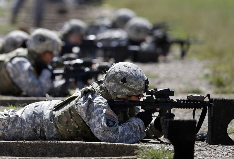 In this Sept. 18, 2012, file photo, female soldiers from 1st Brigade Combat Team, 101st Airborne Division train on a firing range while testing new body armor in Fort Campbell, Ky.