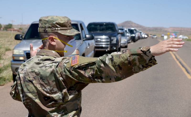 Arizona National Guard service members direct visitor check-in at a temporary COVID-19 testing site on the Navajo Nation May 19, 2020, in Tonalea, Ariz.