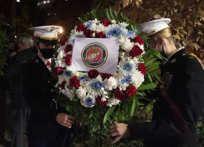 A Navy and Marine Corps honor guard lays a wreath at the Eternal Light Flagstaff in Madison Square Park, Wednesday, Nov. 11, 2020, in New York.