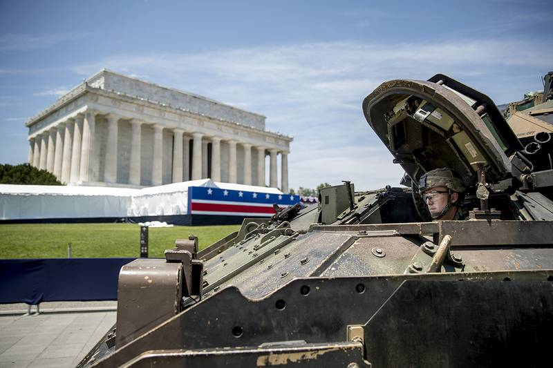 """One of two Bradley Fighting Vehicles waits to be driven into place in front of the Lincoln Memorial for President Donald Trump's """"Salute to America"""" event honoring service branches on Independence Day, Tuesday, July 2, 2019, in Washington."""