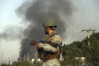 Smoke rises as angry Kabul residents set fire to part of the Green Village compound that has been attacked frequently, a day after a Taliban suicide attack in Kabul, Tuesday, Sept. 3, 2019.