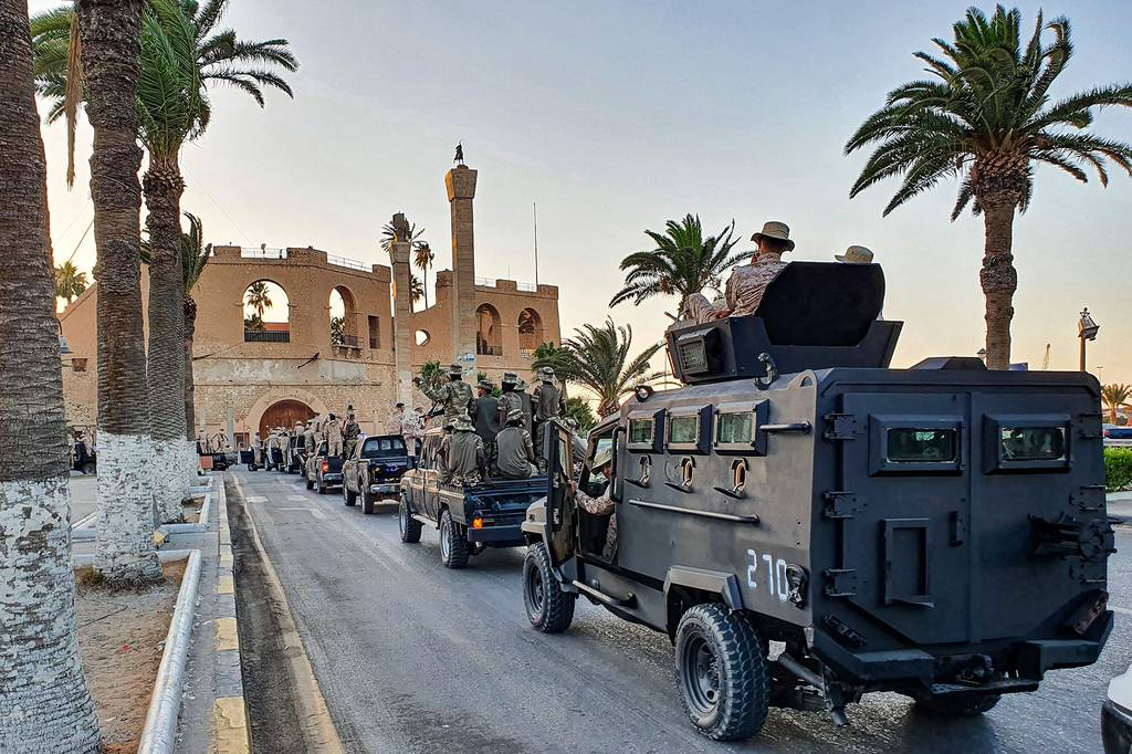"""Vehicles of the """"Tripoli Brigade,"""" a militia loyal to the UN-recognized Government of National Accord (GNA), parade through the Martyrs' Square at the center of the GNA-held Libyan capital Tripoli on July 10, 2020"""