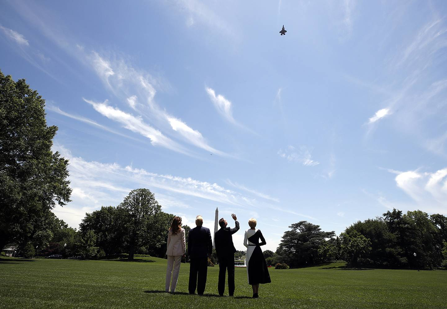 President Donald Trump, first lady Melania Trump, Polish President Andrzej Duda, and his wife Agata Kornhauser-Duda watch a flyover of a F-35 Lightning II jet at the White House, Wednesday, June 12, 2019, in Washington.