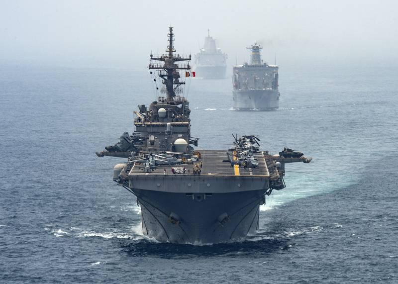 Amphibious assault ship USS Boxer (LHD 4), Fleet replenishment oiler ship USNS Tippecanoe (T-AO 199) and amphibious transport dock ship USS John P. Murtha (LPD 26) transit the Strait of Hormuz on Aug. 12, 2019.