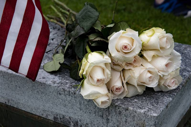 Flowers lay on a bench during a funeral for U.S. Navy Seaman Apprentice Hubert P. Hall at the National Memorial Cemetery of the Pacific, Honolulu, March 17, 2020.