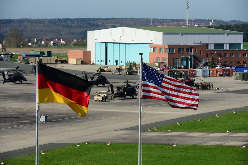 U.S. and German flags fly outside 12th Combat Aviation Brigade Headquarters overlooking the Katterbach Army Airfield in Ansbach, Germany