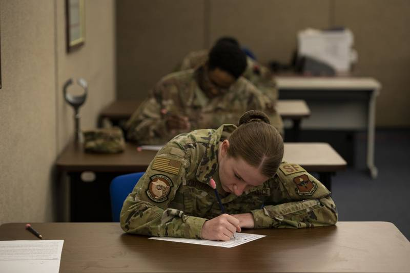 Senior Airman Jewel Favreau, assigned to the 97th Security Forces Squadron, fills out a promotion testing form, May 20, 2020 at Altus Air Force Base, Oklahoma. (Tech. Sgt. Kenneth Norman/Air Force)