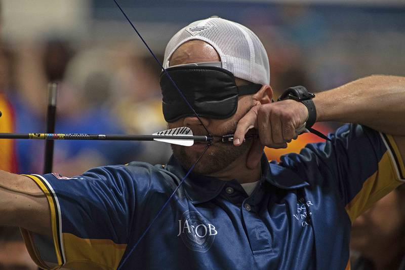 Coast Guard Maritime Enforcement Specialist 2nd Class Jacob Cox competes for Team Navy in archery at the 2019 Department of Defense Warrior Games on June 24 in Tampa, Fla.