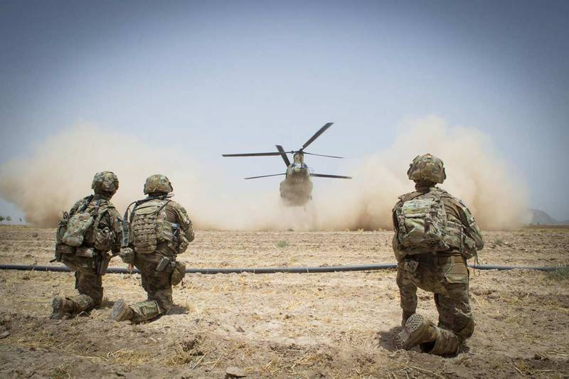 Paratroopers secure a helicopter landing zone for a CH-47 Chinook helicopter, July 20, 2019, in Kandahar Province, Afghanistan.