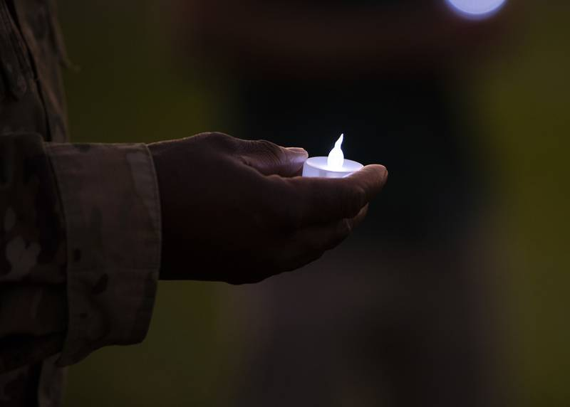 Air Force Maj. Onyema Okorie, 366th Fighter Wing deputy wing chaplain, holds a tea-light candle, Sept. 30, 2020, at Mountain Home Air Force Base, Idaho.