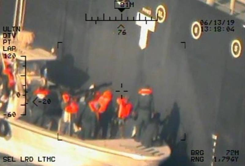 Imagery taken from a U.S. Navy MH-60R helicopter of the Islamic Revolutionary Guard Corps Navy after removing an unexploded limpet mine from the M/T Kokuka Courageous (CENTCOM)