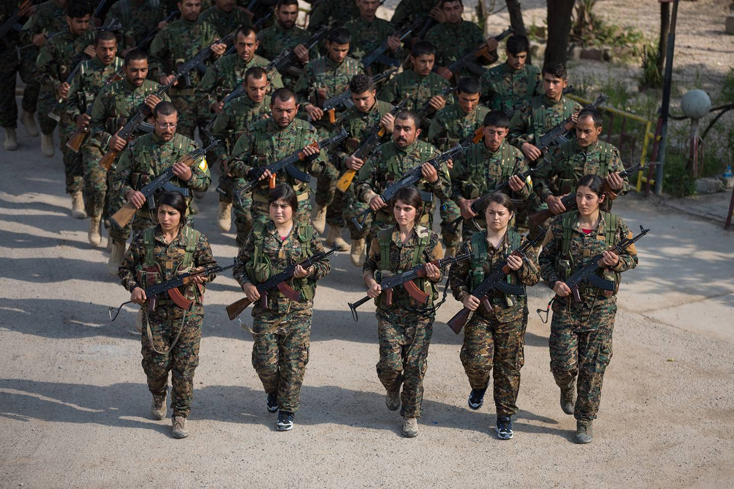 Members of the Syrian Democratic Forces stand in formation