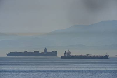 A view of the vessel the Clavel, right, sailing on international waters crossing the Gibraltar stretch on Wednesday, May 20, 2020.