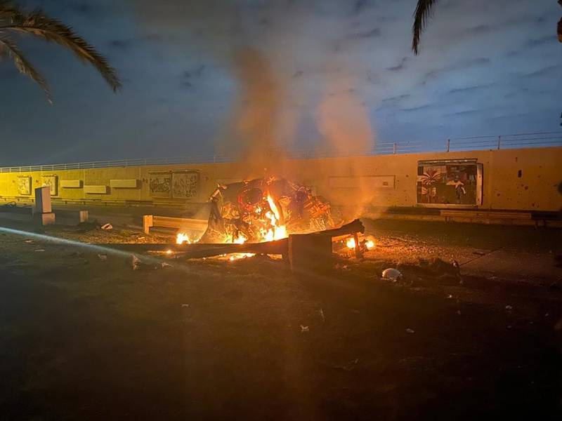 This Jan. 3, 2020, file photo, released by the Iraqi Prime Minister Press Office shows a burning vehicle at the Baghdad International Airport following a deadly airstrike in Baghdad, Iraq.